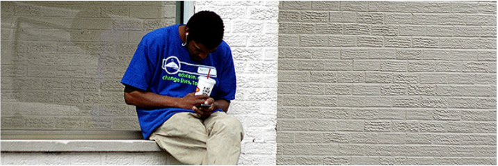 Young man texting.