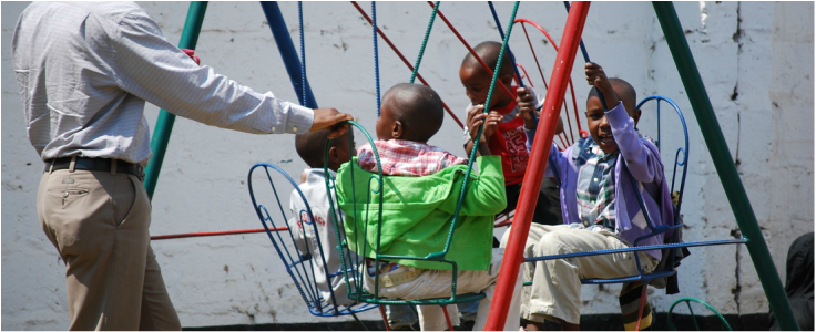 Children on the swings at TTF Clinic