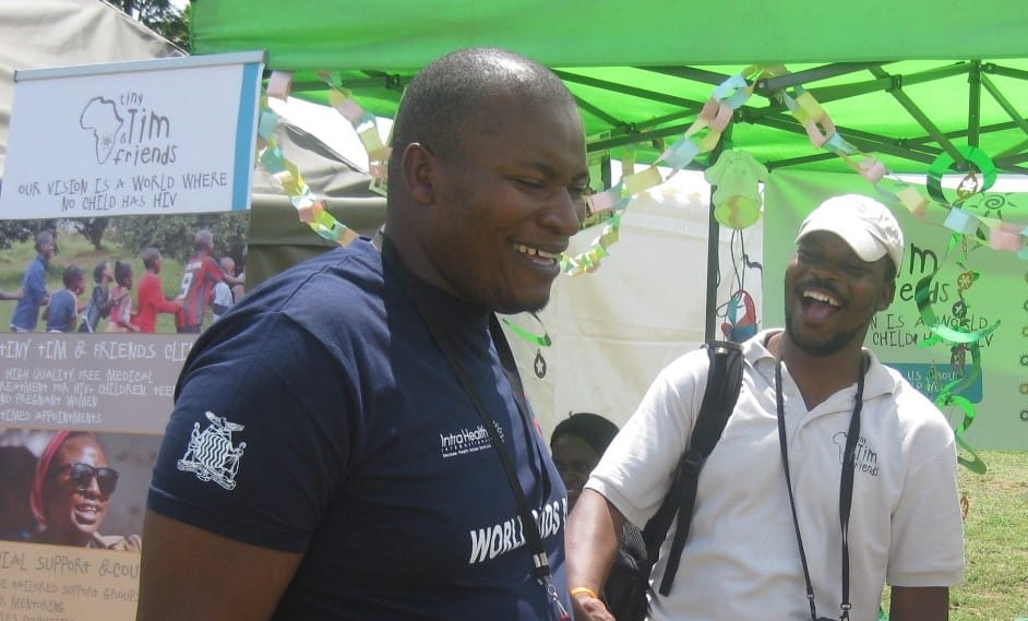 Rodin talking to a partner organisation at World AIDS Day 2016, Lusaka